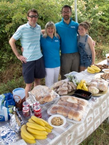 From left to right Tim Hughes, our leader, Will Savage volunteer, Louise Marshall, who spent all night baking cakes for some very hungry cyclists, and Izzy our youngest volunteer and future cyclist!