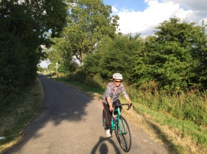 Val on her new bike and Hannah in the background - cycling along Hallamshire Road - a small track between Shepshed and Belton.
